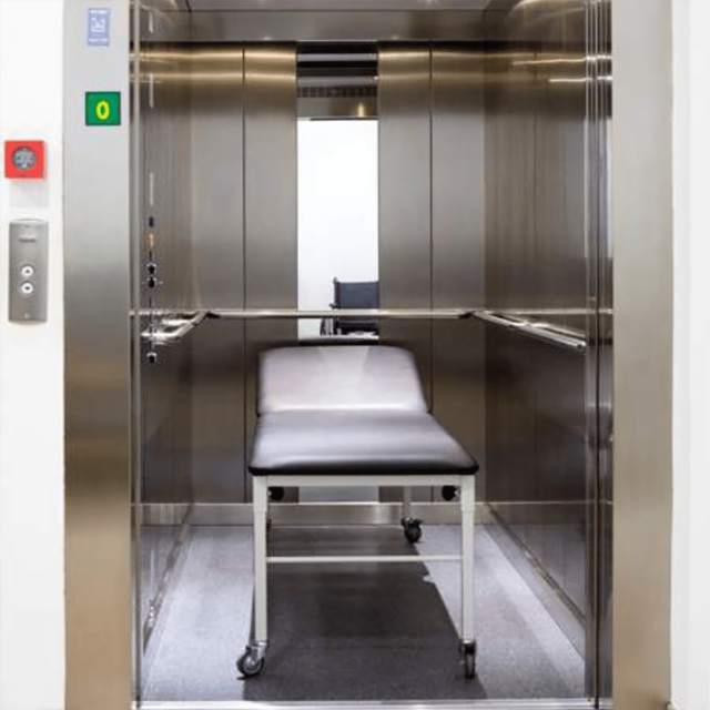 Elevator for loading hospital bed